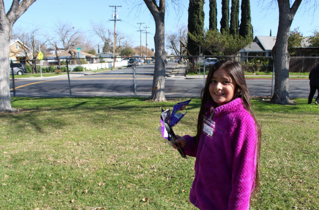 Our programs will encourage all students to get outside and take environmental action in their local community, like this Antioch student during a litter cleanup last year!